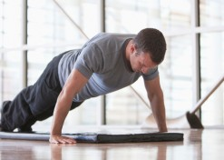 Man doing push-ups in health club  Image downloaded by Sally Berman at 20:31 on the 16/12/13
