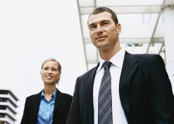 Businessman and a Businesswoman Standing Outdoors