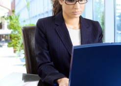 Businesswoman using laptop.