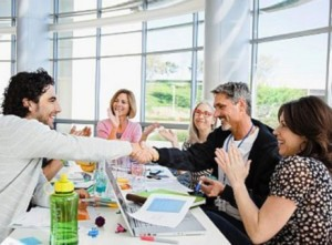 Men shaking hands at meeting, colleagues clapping hands