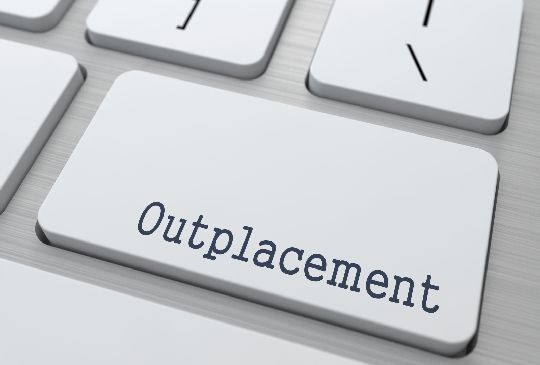 Outplacement - Business Concept. Button on Modern Computer Keyboard.