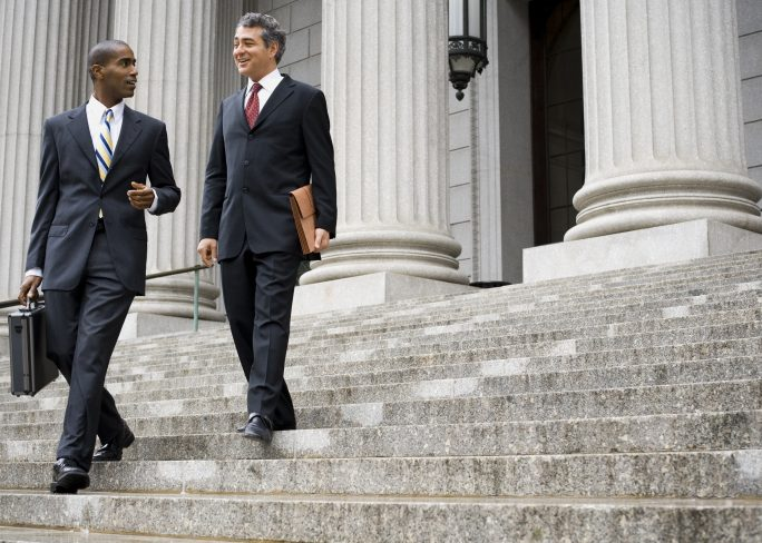 Two Male Executives Walking Down Steps 684x488 - Empleabilidad: Tips para conseguir trabajo